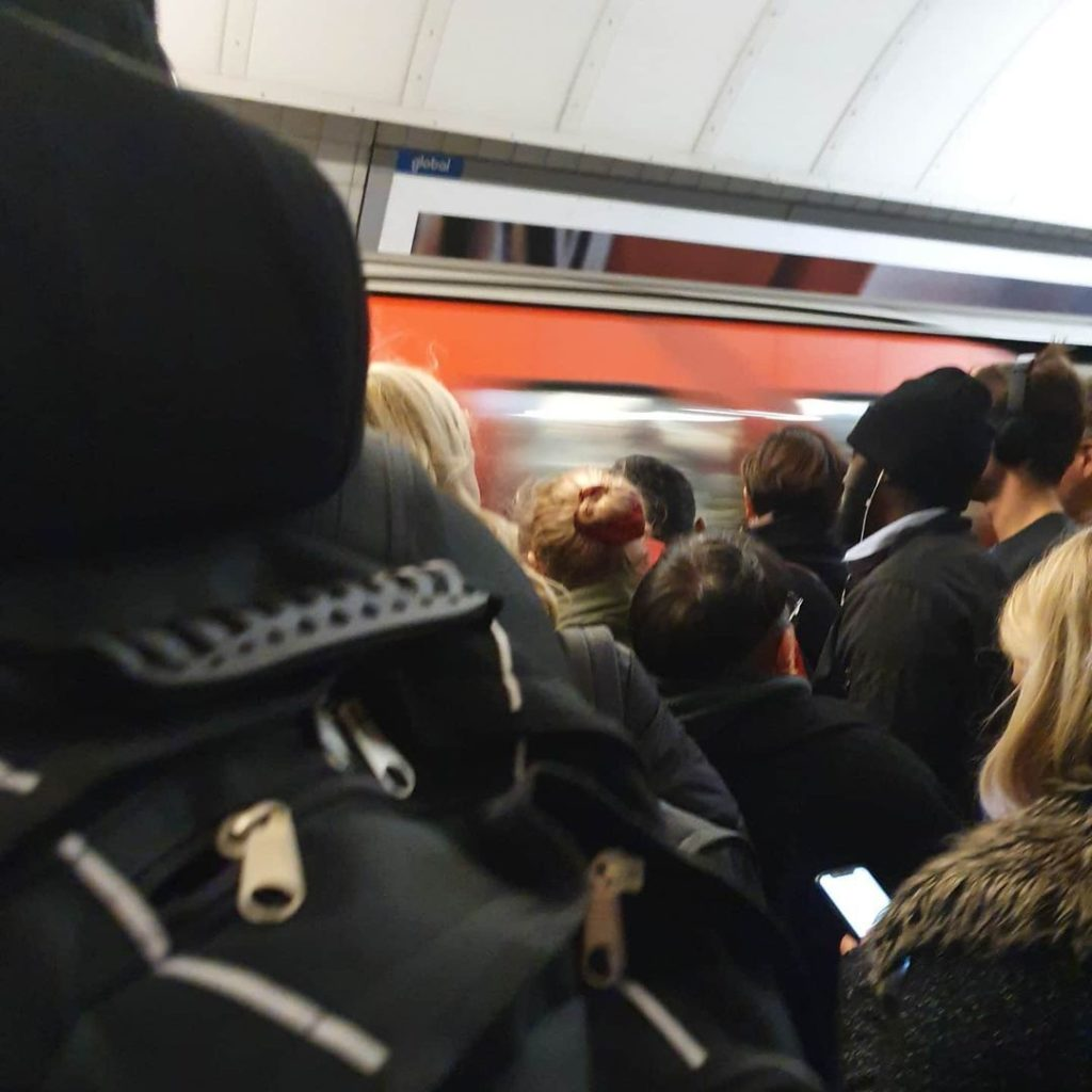 Crowd waiting to get on the tube in London.