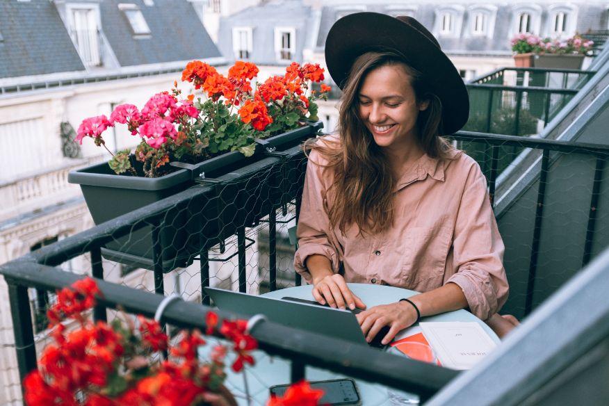 Women working from her balcony