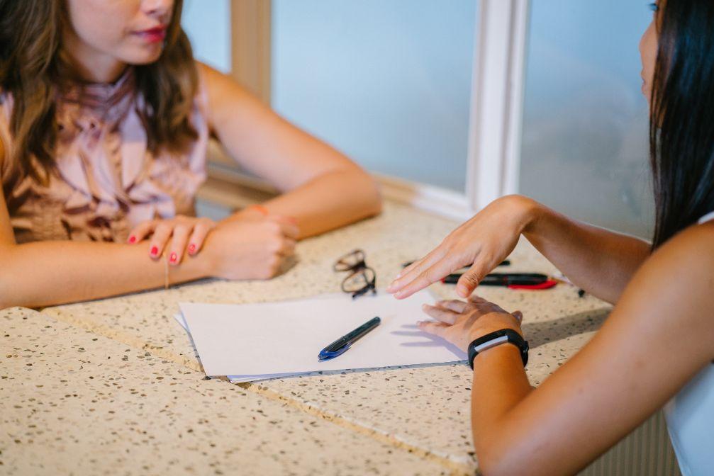 Two women talking in a job interview.